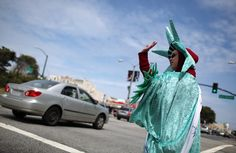 Elizabeth Krasovitov, dressed as the Statue of Liberty, advertises for a Liberty Tax Services tax preparation office on April 14, 2011 in San Francisco, California. Despite having an extra three days to file your income taxes this year, an estimated 15 to 20 million people will wait to the very last minute to file their taxes, with a high number relying on tax preparation services.  (April 13, 2011 - Source: Justin Sullivan/Getty Images North America)
