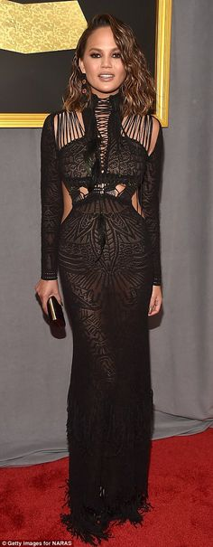 Beauties in black: Chrissy Teigen sported a sultry sheer look while Laverne Cox opted for sexy side cut-outs