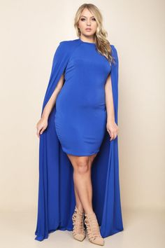 A plus size mini bodycon dress with a round neckline and a caped back. Features arm openings. Solid colored.