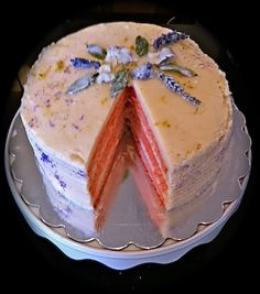 Four layer Pink Lemonade Cake sprinkled with Fresh Lavender and violets. An original creation from Alexander's Chocolate Classics.  Alexander's Chocolate Classics  309 E. Main St.  Dayton Wa  (509) 240-7531 http://www.alexanders-chocolate-classics.com