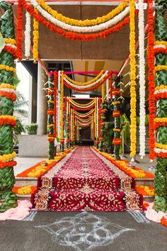 Floral wedding arrangements breathe freshness, beauty and elegance. The key is to know what kind of arrangements work best for your wedding. Here are 5 floral arrangement ideas that make a statement and work beautifully with all kinds of wedding them Desi Wedding Decor, Wedding Hall Decorations, Marriage Decoration, Wedding Entrance, Wedding Mandap, Entrance Decor, Flower Decorations, Wedding Halls, Wedding Ceremony
