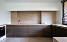 Custom made kitchen by Belgian company WILFRA. Beautiful color and material palette.