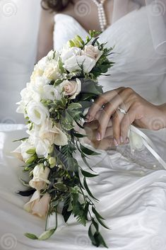 Cascade bouquets don't have to have intense waterfalls of flowers, sometimes just a few tendrils does the trick better.