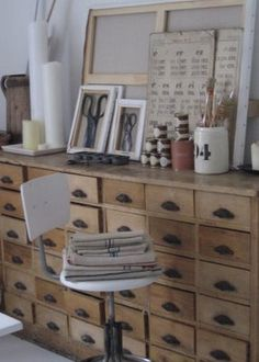 many drawers, white stool, framed scissors