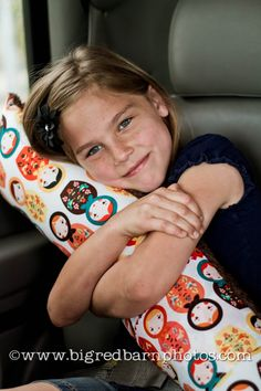 Car Pillow - long narrow piece filled with stuffing. Sew two loops on backside which Velcro around seat belt.