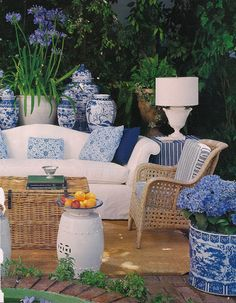 cute outdoor patio - blue flower pots - nice!