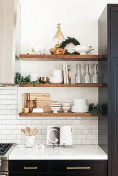 wood shelves, white subway tile backsplash
