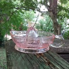 Check out this item in my Etsy shop https://www.etsy.com/listing/481213275/pink-glass-juicer-vintage-reamer-shabby