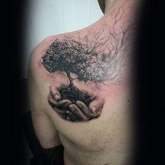 Hand Holding Tree Of Life Realsitic Mens Upper Back Tattoo