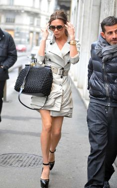 Victoria Beckham in Burberry trench.