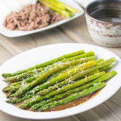 Roasted Asparagus with Balsamic Soy Dressing topped with Asiago Cheese.