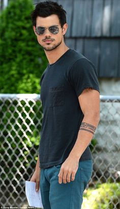 On location: Taylor Lautner kept cool behind aviator sunglasses on Friday on the set of his new movie Tracers in the Maspeth neighbourhood of Queens in New York City