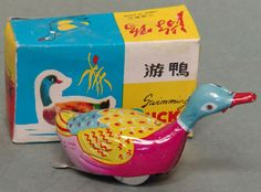 Made in China and circa the About 3 inches long - wind it up and it travels forward with the legs kicking as if swimming. Complete with original box and key. Vintage Tins, Tin Toys, Antique Toys, Battery Operated, Drones, The Past, Swimming, China, Cool Stuff