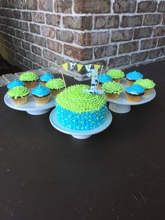Boys first birthday cake with cupcakes