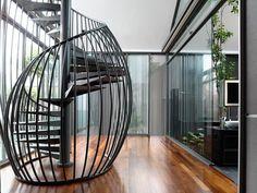 Singapore interior design house with a metallic spiral staircase