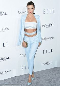 Buckle up! Miranda Kerr had all eyes on her on Monday evening as she showed off her super toned abs in a belt and bandage crop top and matching ice blue suit at the Annual ELLE Women in Hollywood Awards