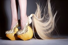 Masaya Kushino heelless crazy hair ponytail shoes. I kinda love them... :)  I think Gaga will be wearing these soon!