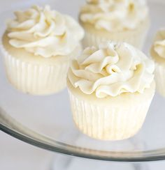 Very Vanilla Cupcakes- made from a doctored cake mix, but taste like they are from scratch!