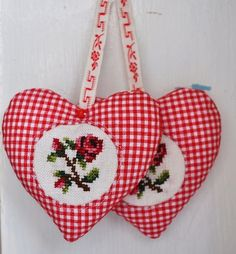 two sweet cross-stitch rose hearts..