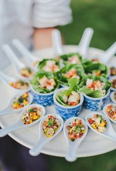 Turn Asian-style soup spoons and tea cups into vessels for assorted salads in bite-size portions.