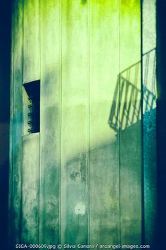 Lonely tiny window on a building cement wall with shadow - ©Silvia Ganora Photography - All Rights Reserved  #architecture