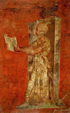 Da Pompei. Tempio di Iside, portico nord. Il sacerdote che legge sul rotolo di papiro le formule del rituale era detto hierogrammateus o anche pteroforo per le sue piume di struzzo che gli ornavano il capo. napoli, Museo Archeologico Nazionale, inv. 8925.