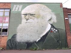 """This enormous Charles Darwin was painted by in Sheffield. Rocket has been painting green paintings all round the Sheffield City Centre, focusing on greenery and nature. In Rocket's own words """"Darwin is a perfect symbol for nature."""" The CND. Nuclear Disarmament, Sheffield City, Sheffield England, Green Paintings, Alternative Art, Charles Darwin, Public Art, Amazing Art, Wall Murals"""