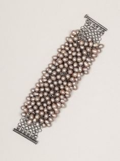 FRESHWATER PEARL CUFF  - ooo, I want to make this Now! will be time consuming but so worth it.