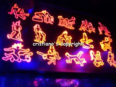 Bangkok, Thailand's infamous Patpong go go bars.  The sign may help you understand exactly what goods they're selling...