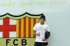 Neymar poses for the media after signing as a new player of the FC Barcelona at Camp Nou sports complex on June 3, 2013 in Barcelona, Spain