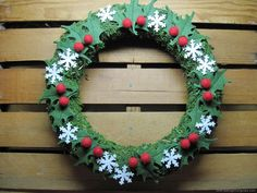 A sweet handmade holly wreath from the Handmade Gift Exchange at Craftaholics Anonymous
