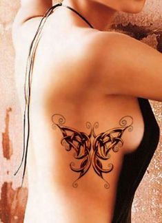 Celtic Butterfly Tattoo on Rib Cage in blue white and green