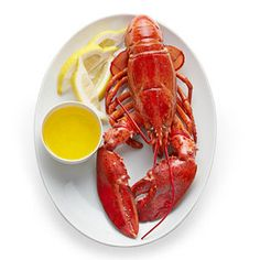 Simple is best. Lobster, melted butter, lemon.      (Photograph by Yunhee Kim for The New York Times; Food stylist: Megan Schlow. Prop stylist: Deborah Williams.)