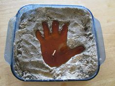 hand print sand candles  make hand print in sand, insert wick, pour in wax, let harden, remove hand candle