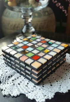 This coaster set includes light orange and cream colored tiles with splashes of color! Deep orange, green, mirrored, and translucent stained