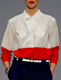 a5b6049261148 Interestingly composed with vertical pinstripes with a broad horizontal  stripe at the bottom of the shirt in block red. High contrast in colour.