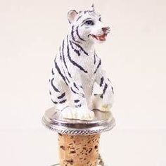 White Tiger Wine Bottle Stopper - ATB11B by Conversation Concepts. $9.38. Great Wine Lover Gift. Fits a Standard Wine Bottle. Pewter Base with Ring and Chain to keep with bottle. Die Cast Poly Resin White Tiger is Hand Painted. Wine Safe Cork. Your favorite white tiger will be the toast of the town on these pewter-base, cork bottle stoppers, designed to fit any standard bottle. Each Stone Resin, Hand Painted White Tiger Wine Stopper comes with it's own velvet drawstring pouch - ...