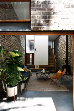 The timber staircase at Walter Street Terrace by David Boyle Architect terminates with a comfortable place to sit - an extension of the living area (via Lunchbox Architect) Sydney, Recycled Brick, Recycled House, Mezzanine Bedroom, High Walls, Home Office, Modular Design, Exposed Brick, Architecture Design
