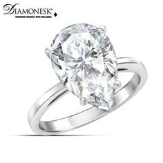 Solid sterling silver ring glitters with a Diamonesk® pear-shaped simulated diamond of over 7 carats. Includes keepsake card and gift box.