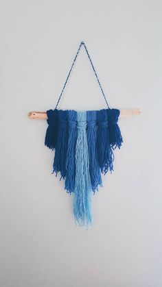 This lovely blue ombre yarn and driftwood wall hanging stuns with its minimal, yet charming simplicity. { item specifics } Measurements: