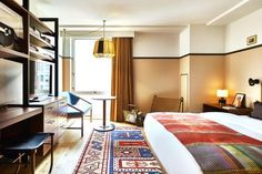 This stylish hotel with a social justice mission attracts hip young travellers with its artisan design features, new-age wellness programme, and quality drink and dining offerings. Retro furnishings, an impressive library, radio station, political art gallery and cinema add to the unique appeal of this bold concept. Stairs And Doors, Interior Architecture, Interior Design, Bohemian Decor, New York Times, Ny Times, Hotel Room Design, Bed, Political Art