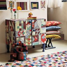 Furniture covered in wallpaper that has been cut into quilt pieces