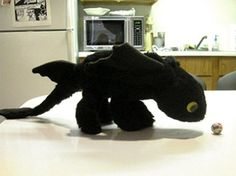 His name is Toothless from HTTYD2.  Dragon Plush Pattern by Rhini on Etsy, $10.00