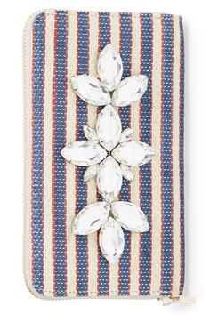 Crisp navy and red nautical stripes are glammed up the floral arrangement of sparkly crystals on this slim wallet that can act as a chic little clutch in a pinch. @nordstrom #nordstrom