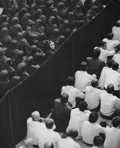 Fevor (Shirin Neshat) Juxtaposing the men against the women - Diagonal Line separating them and then the woman looking back, forming the main element of interest