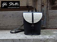 """Zainetto artigianale in cuoio lavorato e cucito a mano """"Pixie"""", decorato con spartiti musicali vintage originali. Vai al link per tutte le info: http://glistolti.shopmania.biz/compra/zainetto-artigianale-in-cuoio-pixie-spartiti-musicali-558 Gli Stolti Original Design. Handmade in Italy. #glistolti #moda #artigianato #madeinitaly #design #stile #roma #rome #shopping #fashion #handmade #style #leather #cuoio #musica #music"""