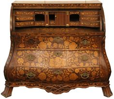 EARLY 20TH C DUTCH MARQUETRY DESK Large Dutch marquetry desk, circa early 20th C.; Bombay style with roll top and heavy floral motif decoration, includes key. Size: 44 x 44.5 x 22""