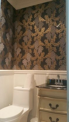 Friday's install. Farrow and ball Wisteria in Black and Gold in a powder room
