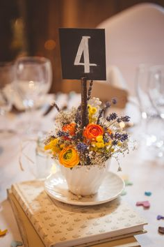 Rustic Romantic Barn Wedding. Table decor with tea cups wild flowers. Photo by Heline Bekker.