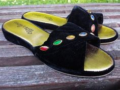 These vintage slippers dont look like they were worn more than a few times. Velvet upper embellished with colored plastic stones. Leather bottom.  7 M